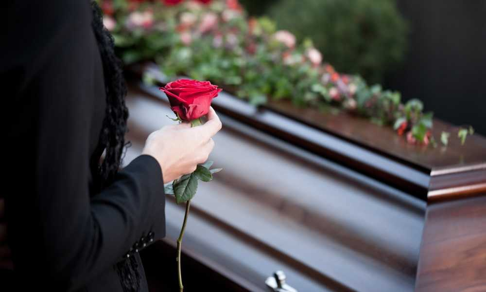 Image result for two coffins with roses